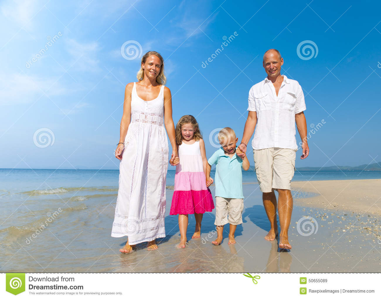Family Walking Beach Holiday Vacations Concept