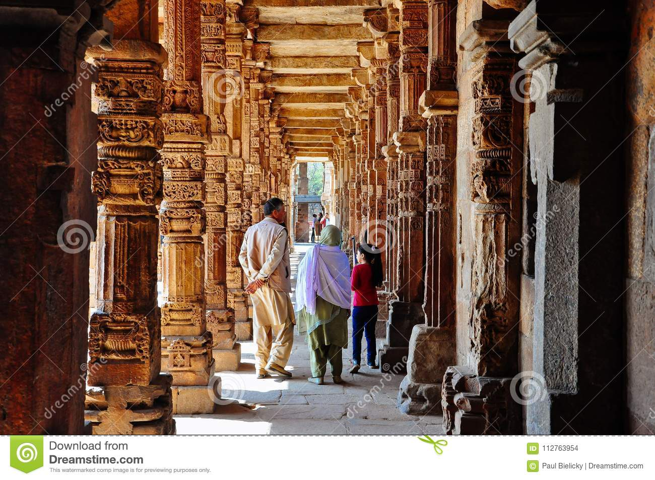 A family walks through Qutab Minar near Delhi, India.