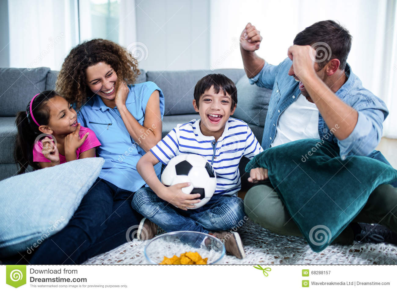 family watching match together on television royaltyfree