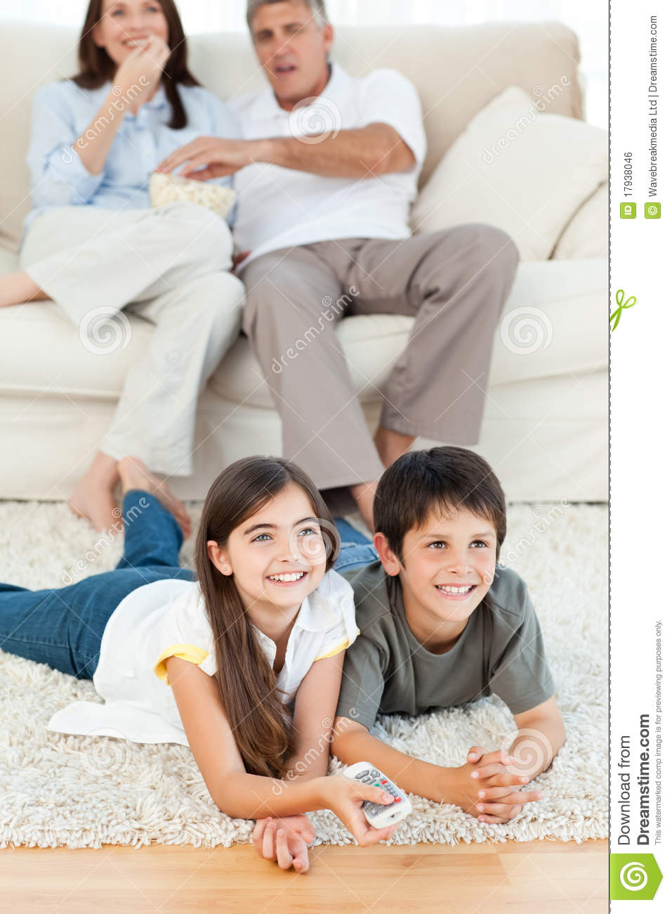 Family watching tv in the living room royalty free stock for Family in the living room