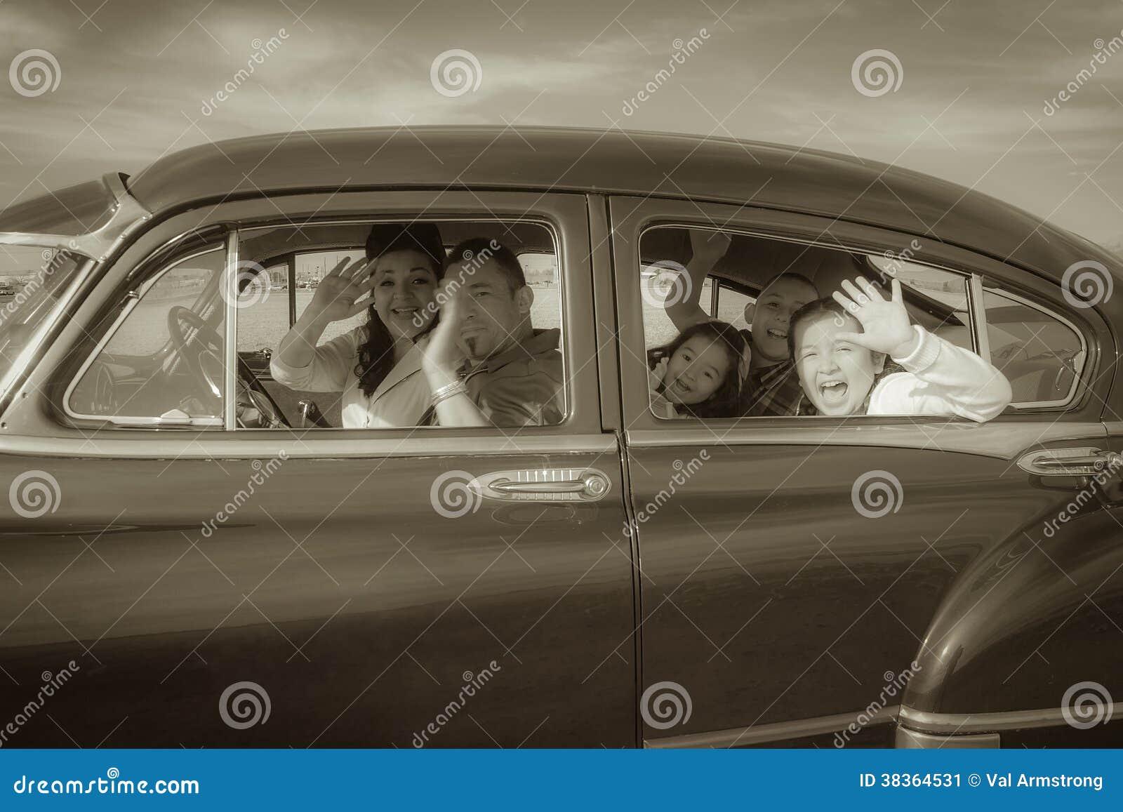 Family Waving Hello in Vintage Car