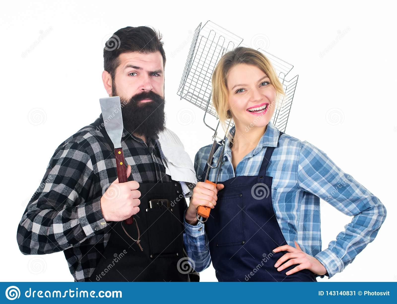 Family weekend. Picnic barbecue. food cooking recipe. Couple in love hold kitchen utensils. Man bearded hipster and girl