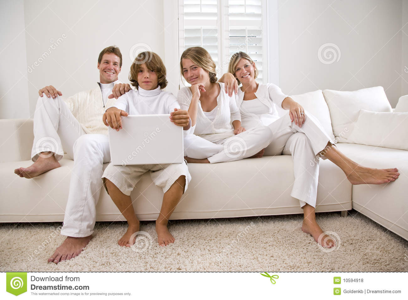 Family In White On White Sofa Stock Photo   Image Of Parents, Window:  10594918