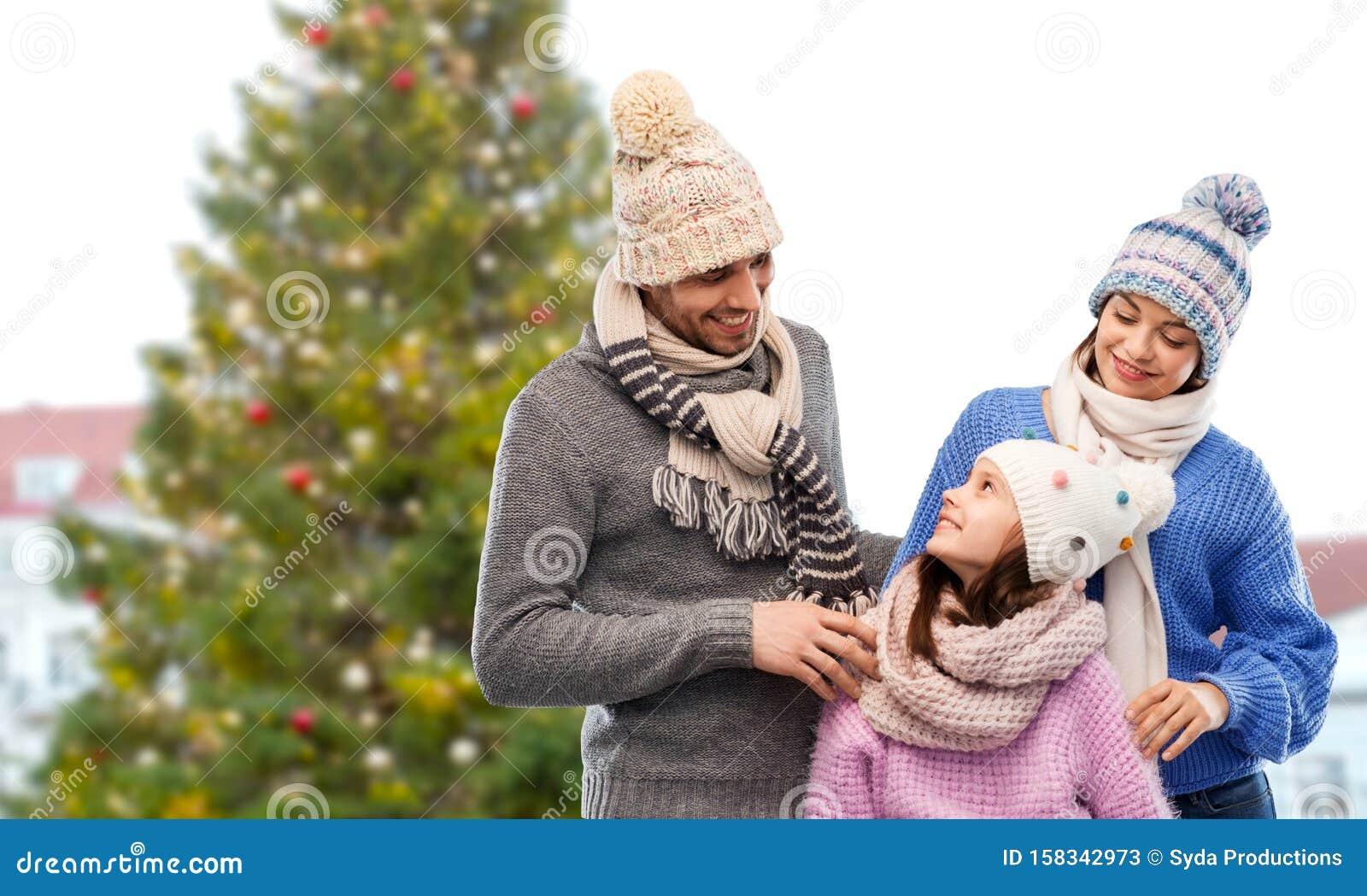 Happy family over christmas tree in tallinn