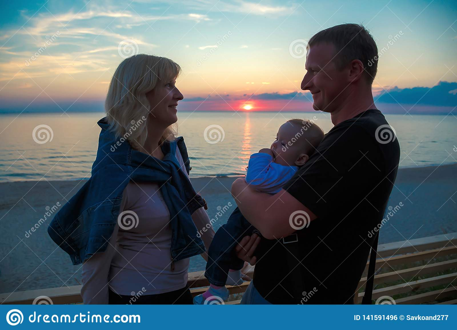 Family with a young child on the shore of the Baltic Sea