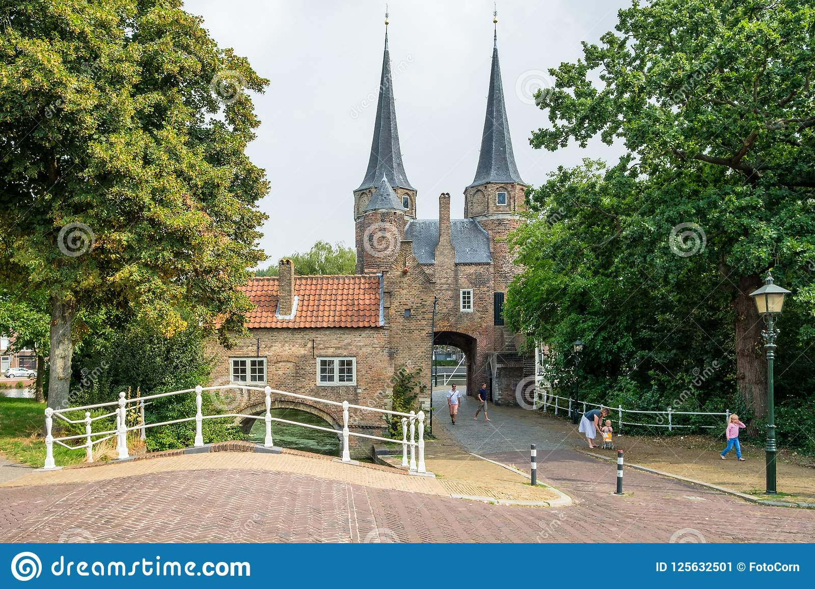 A family with young children visit the Eastern Gate an old city gate of Delft, the Netherlands.