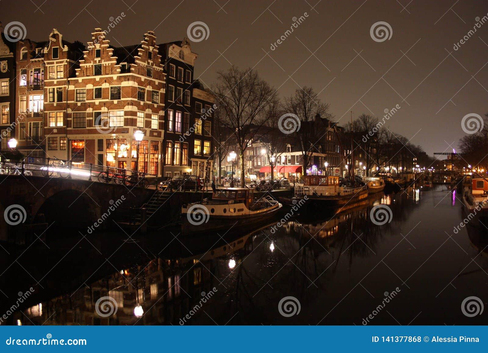 Famous bridge in amsterdam. romantic night landscape. a bit of haze and fog makes the magic channel