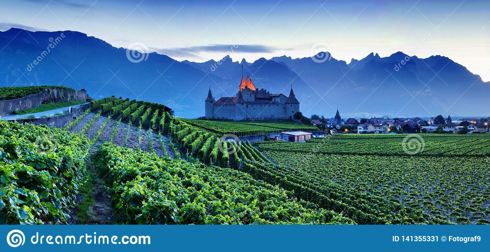 Famous castle Chateau d`Aigle in canton Vaud, Switzerland. Castle in Aigle is overlooking surrounding vineyards and the Alps.