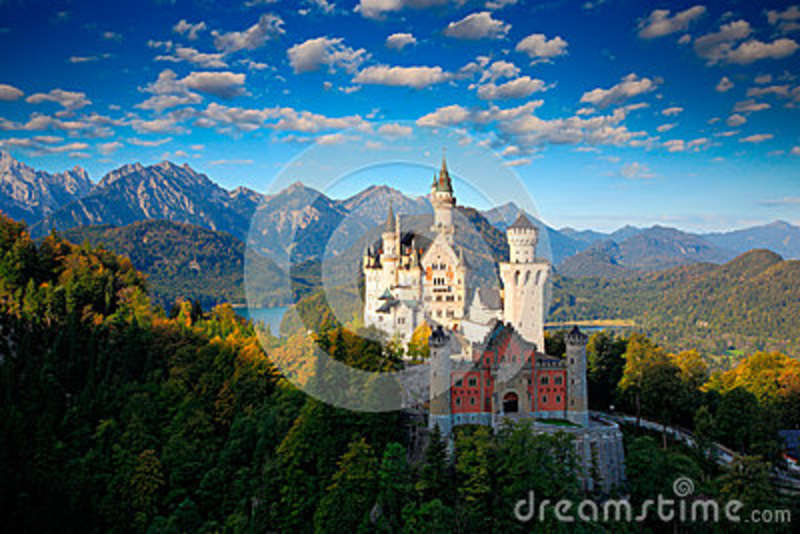 Famous fairy tale Castle in Bavaria, Neuschwanstein, Germany, morning with blue sky with white clouds