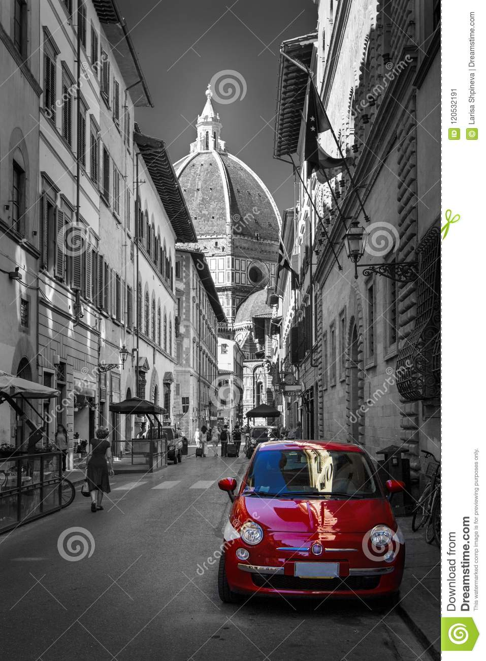 Famous historic red car in Florence street. Color in black and white. Old charming auto concept.