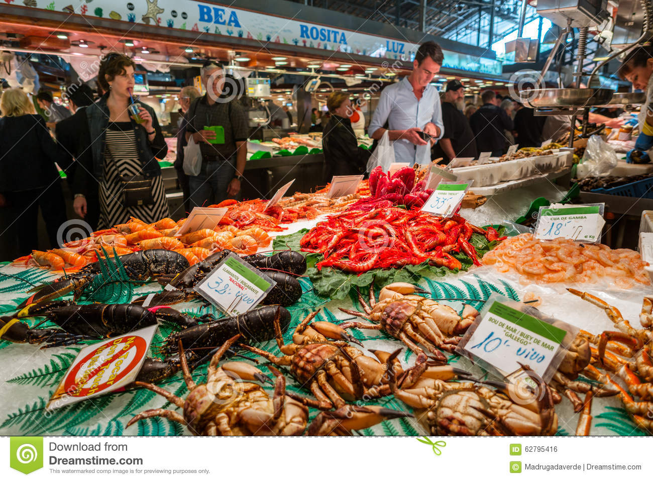 Famous la boqueria market with seafood in barcelona for Seafood fish market