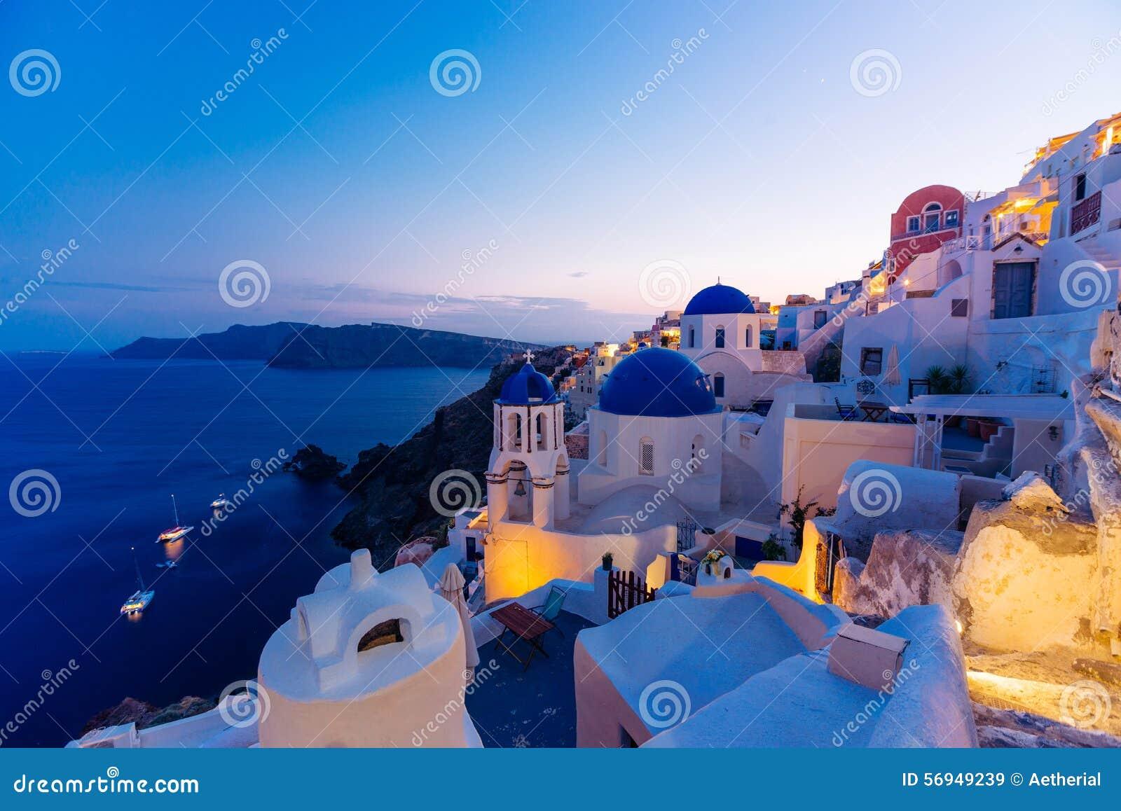 Famous Santorini blue dome churches at night, Oia, Santorini, Greece