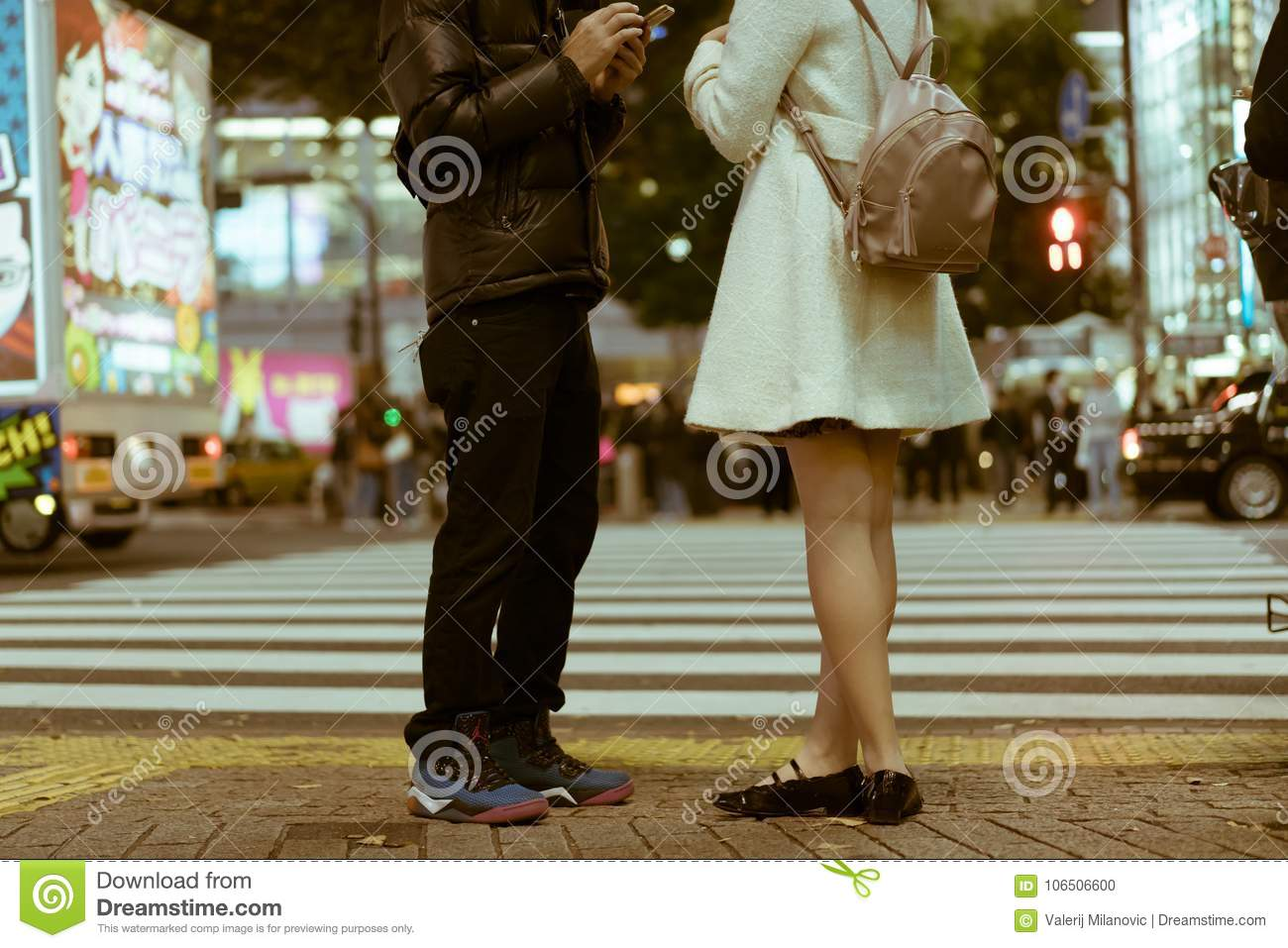 Dating Couple Standing By The Shibuya Crossing And