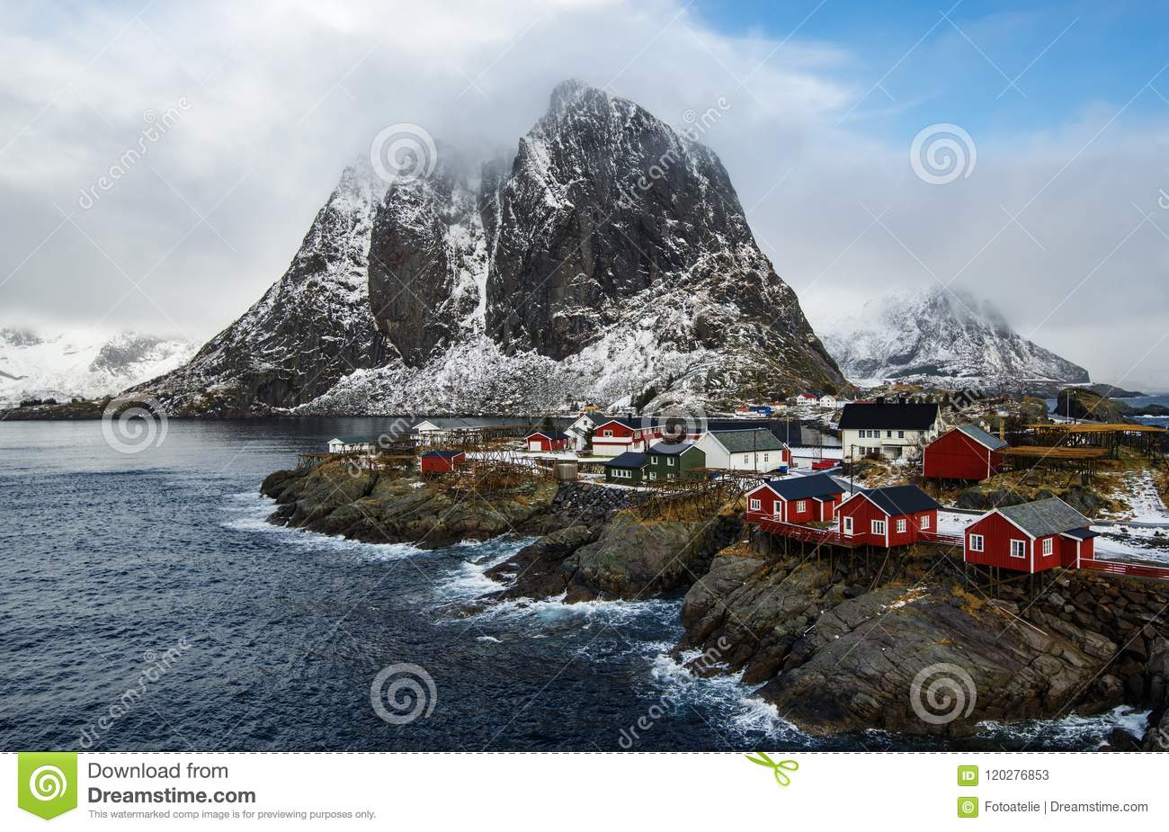 Famous tourist attraction Hamnoy fishing village on Lofoten Islands, Norway with red rorbu houses in winter.