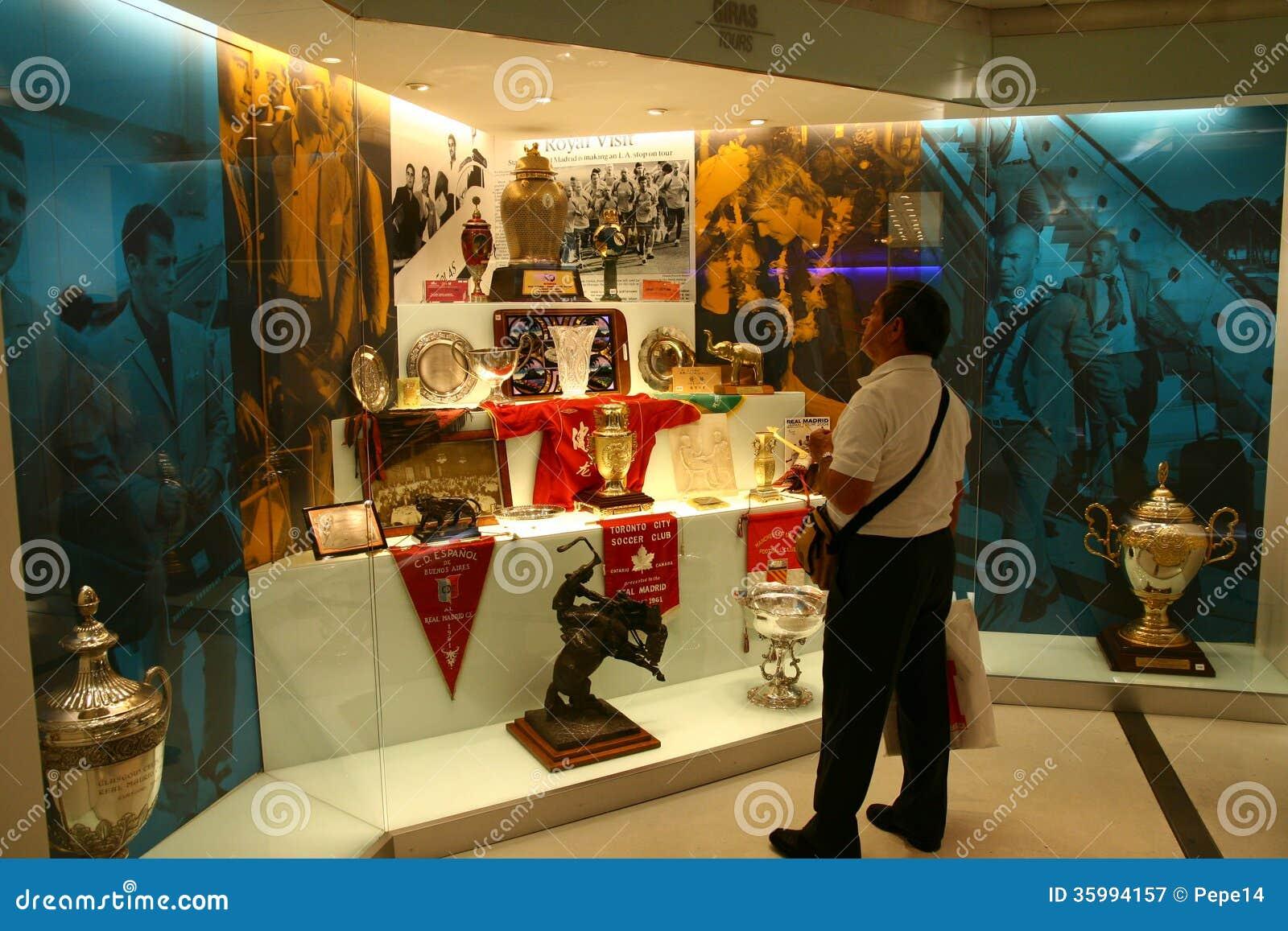 Fan admiring football cups