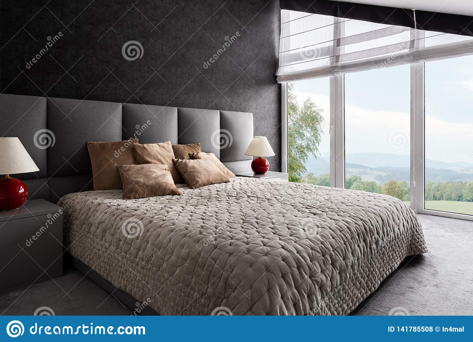 Fancy bedroom with window wall
