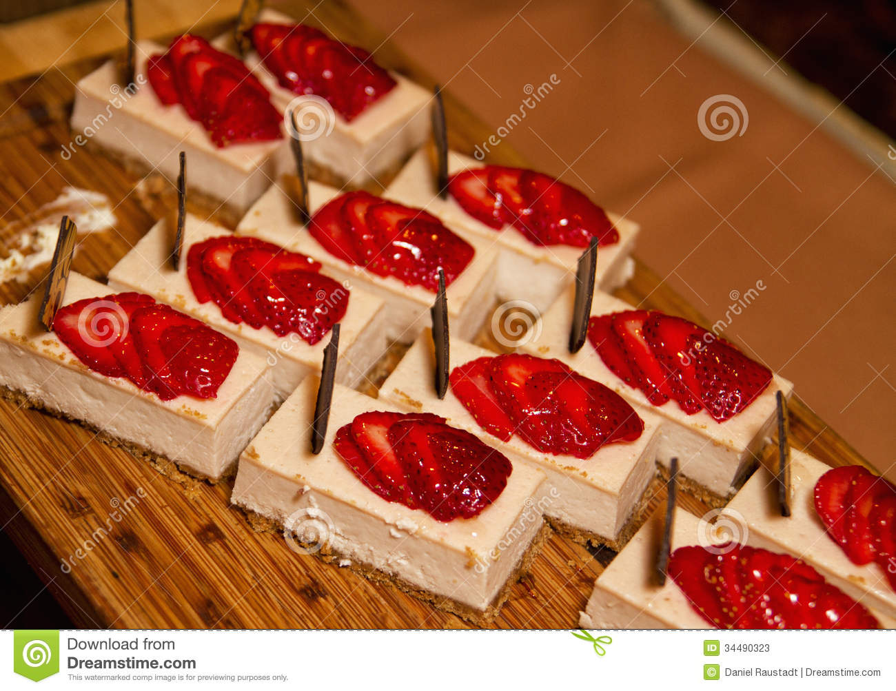 Decorated squares of fresh and fancy cheesecake desserts.