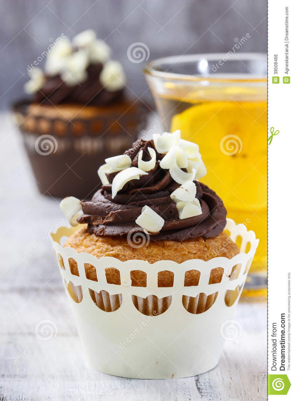 Fancy chocolate cupcakes on wooden table