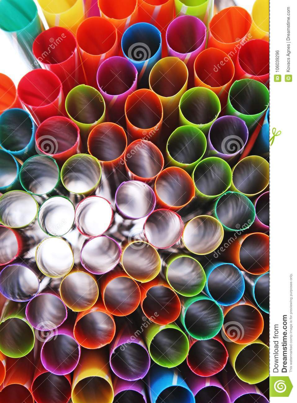 Fancy straw art background. Abstract wallpaper of colored fancy straws. Rainbow colored colorful pattern texture.