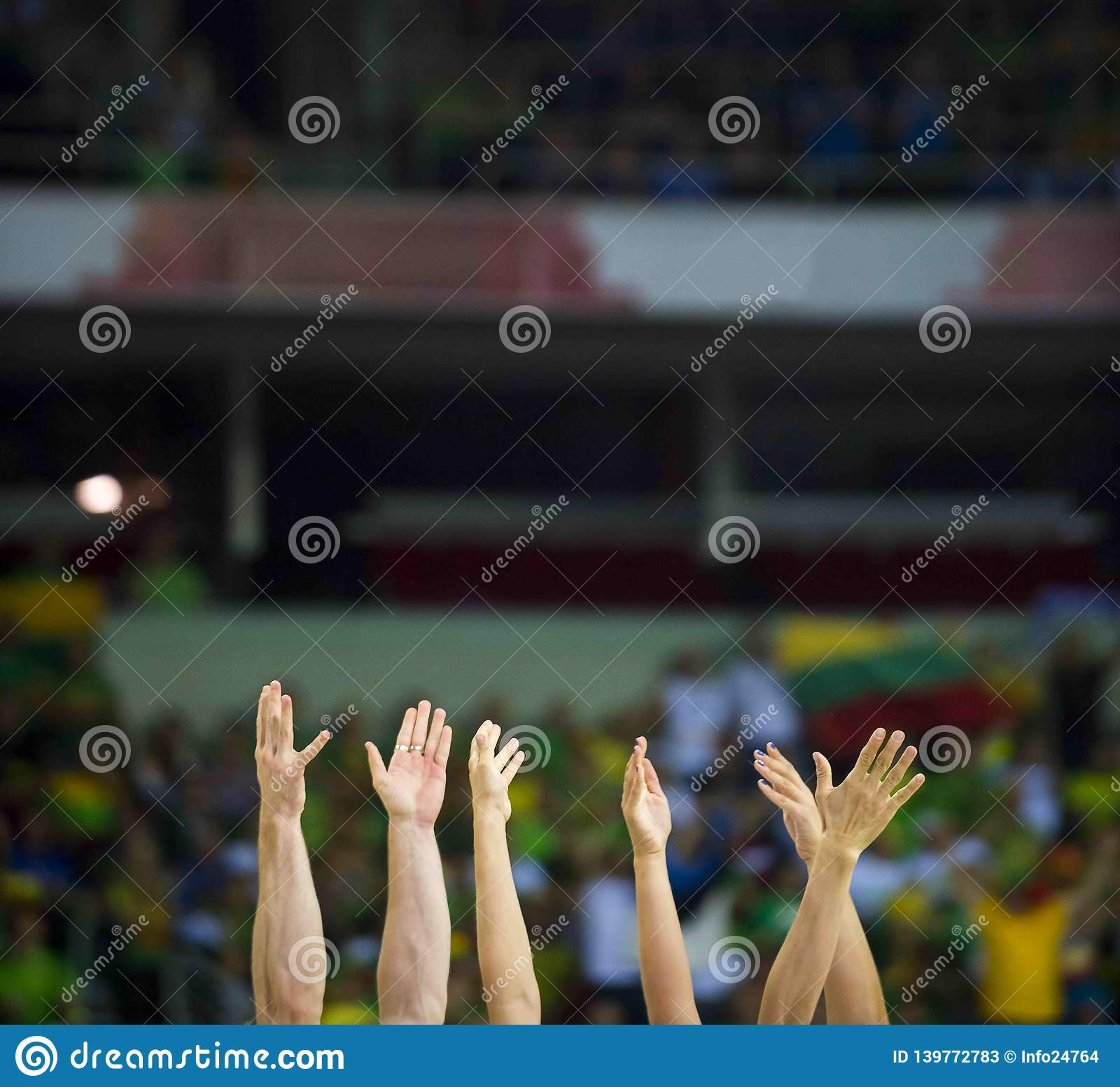 Fans clapping on the podium of the stadium