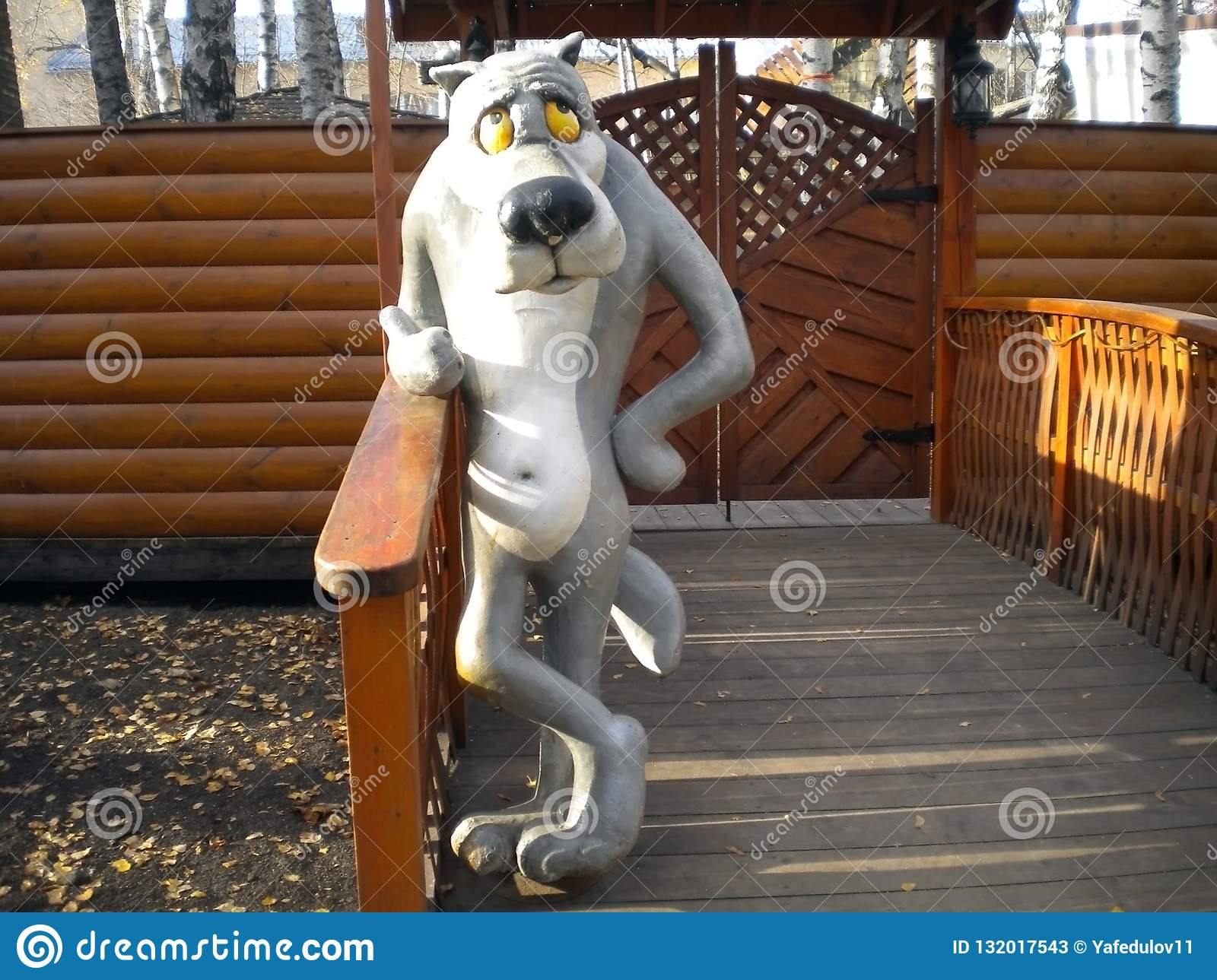 Fantastic character wolf stands near the entrance to the playground