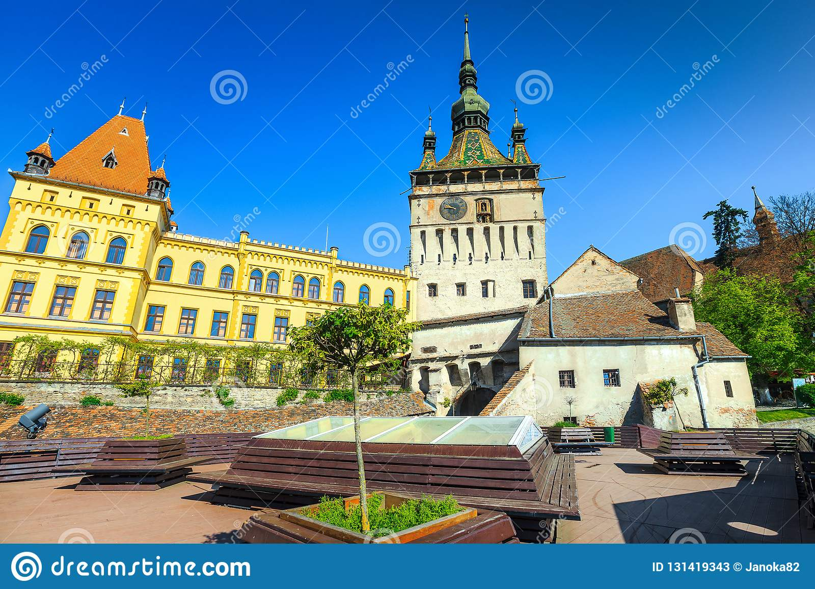 Fantastic clock tower building in the best touristic city, resting place with benches, Sighisoara, Transylvania, Romania, Europe