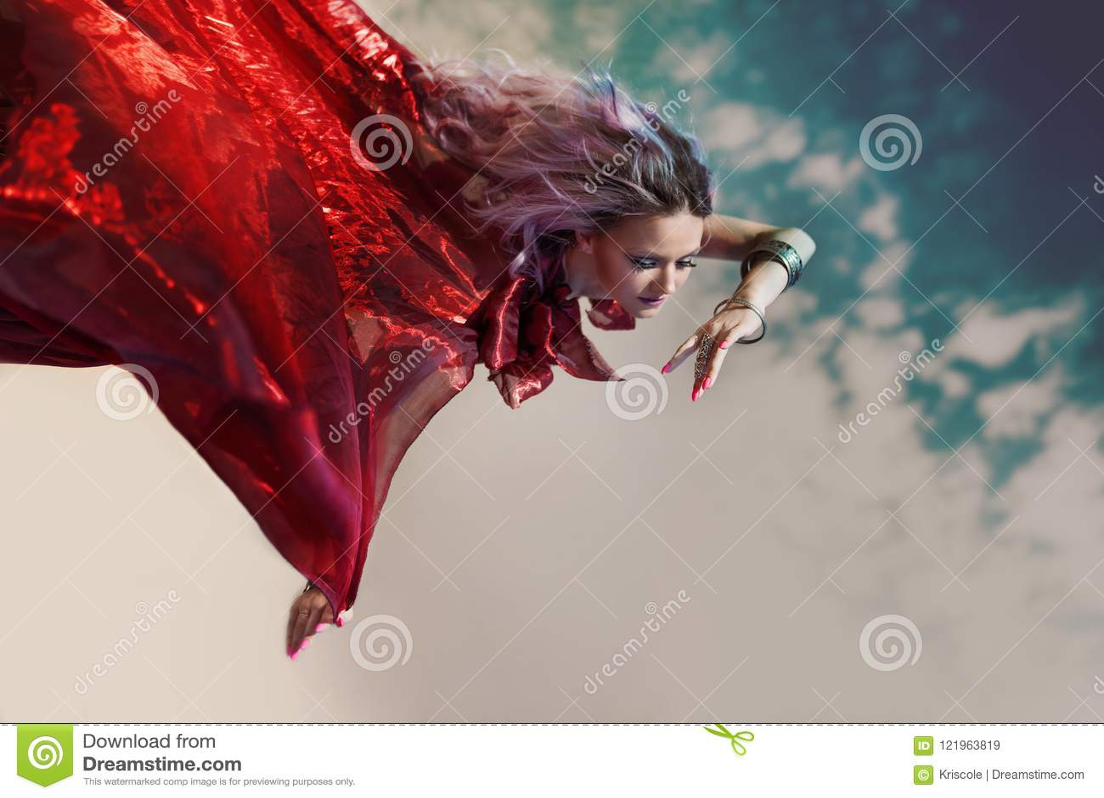 b3b1fcfa17e Fantastic Nymph Flies. Fabulous Portrait Of A Flying Woman In A Red ...