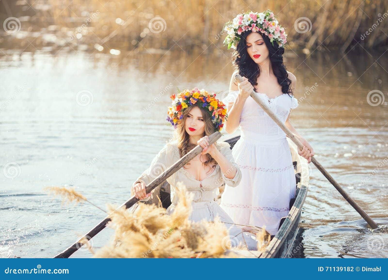 Fantasy art photo of a beautiful girls in boat