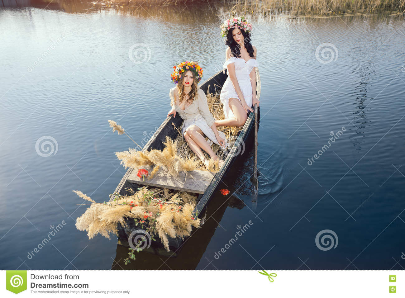 Fantasy art photo of a beautiful girls lying in boat