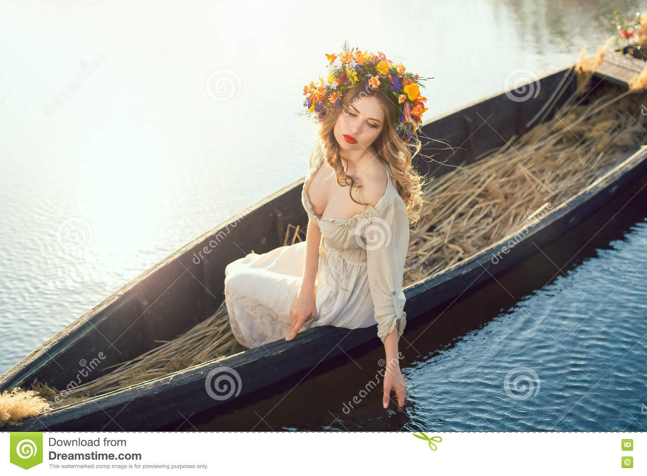 Fantasy Art Photo Of A Beautiful Lady Lying In Boat Stock