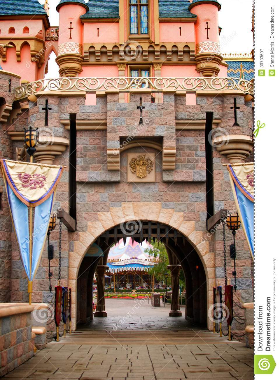 Fantasy Castle With Flags And Iron Gate Stock Image