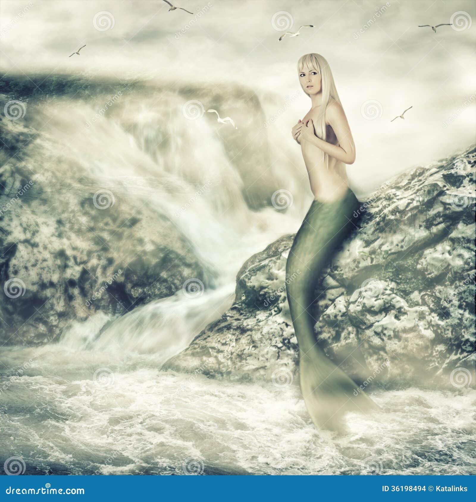 Fantasy World. Beauty ... Fantasy Mermaids On Rocks