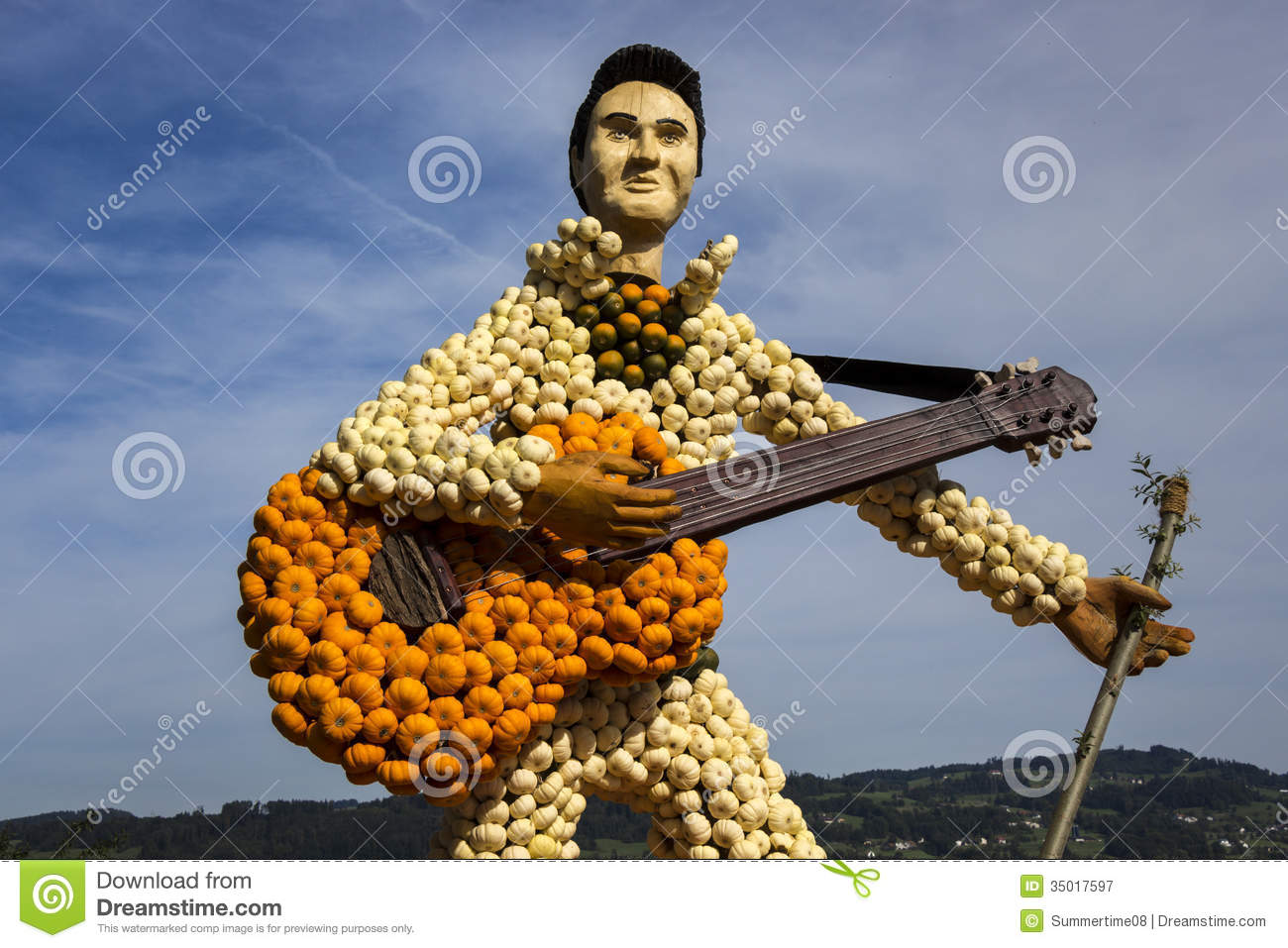 Farm art guitar and guitarist made of small orange, green and white pumpkins