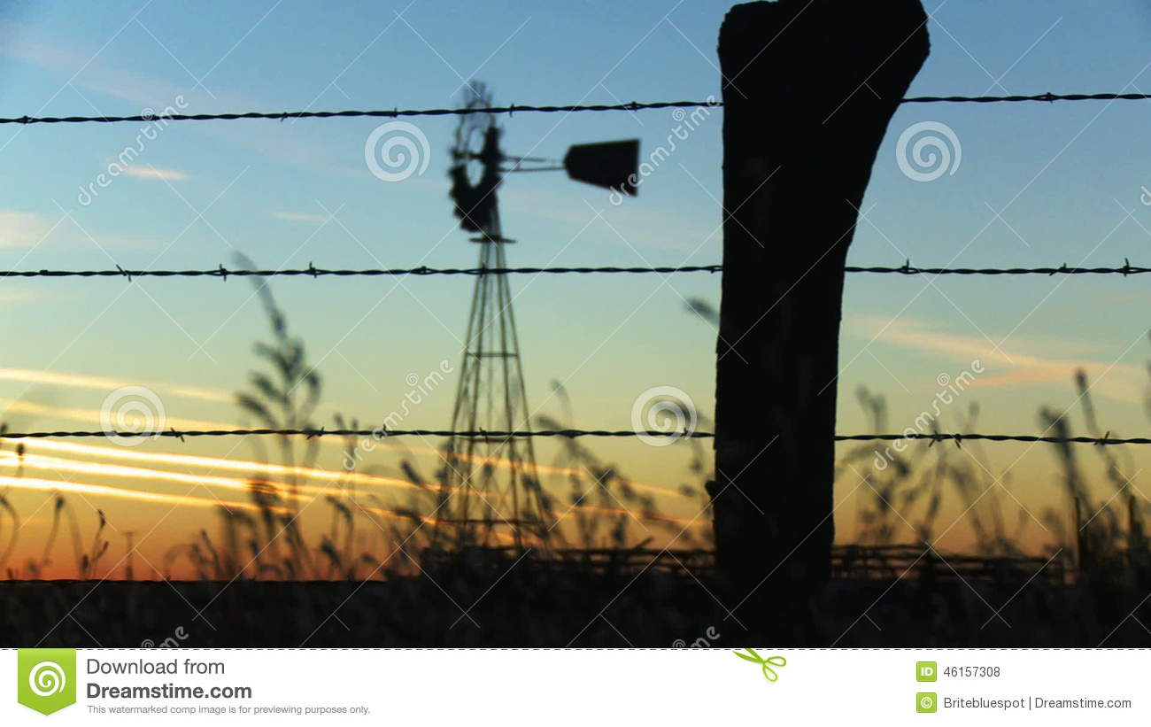 Farm Fence Rack Focus To Windmill Stock Footage - Video of irrigate ...