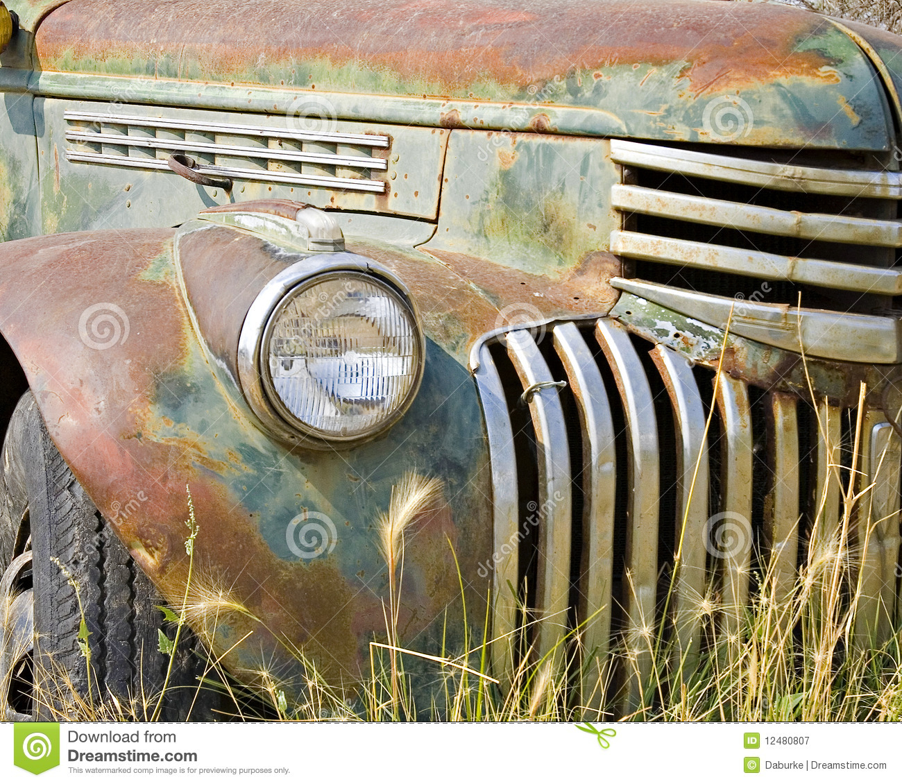 old rusted pickup truck front grille