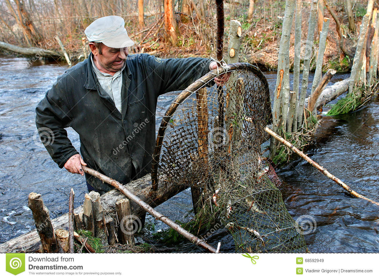 Farmer catch fish in river using hoop net fishing traps for Hoop net fishing
