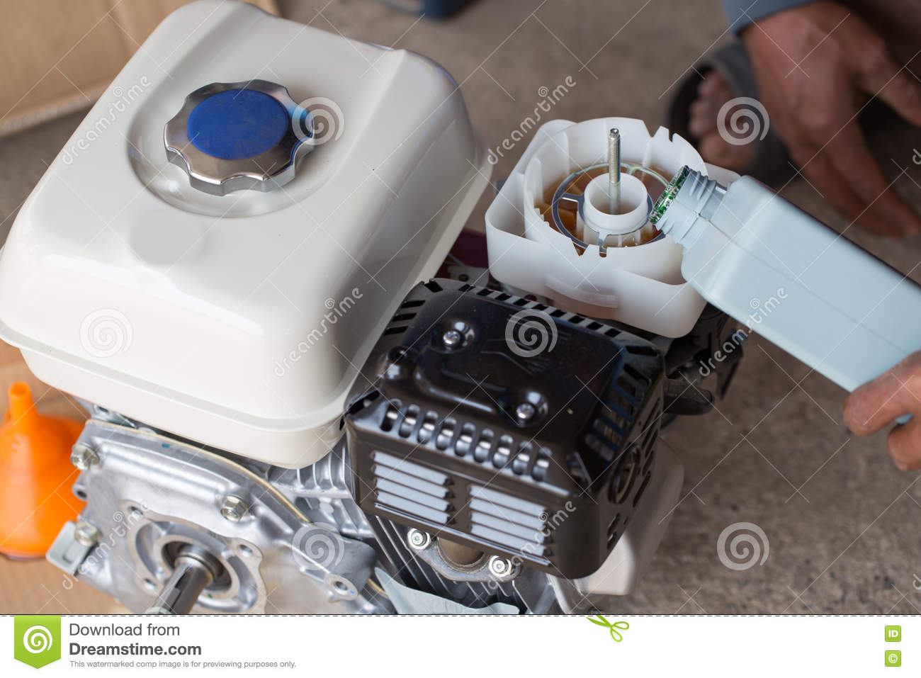 Farmer fill engine oil into oil filter of water pump stock for Water in motor oil