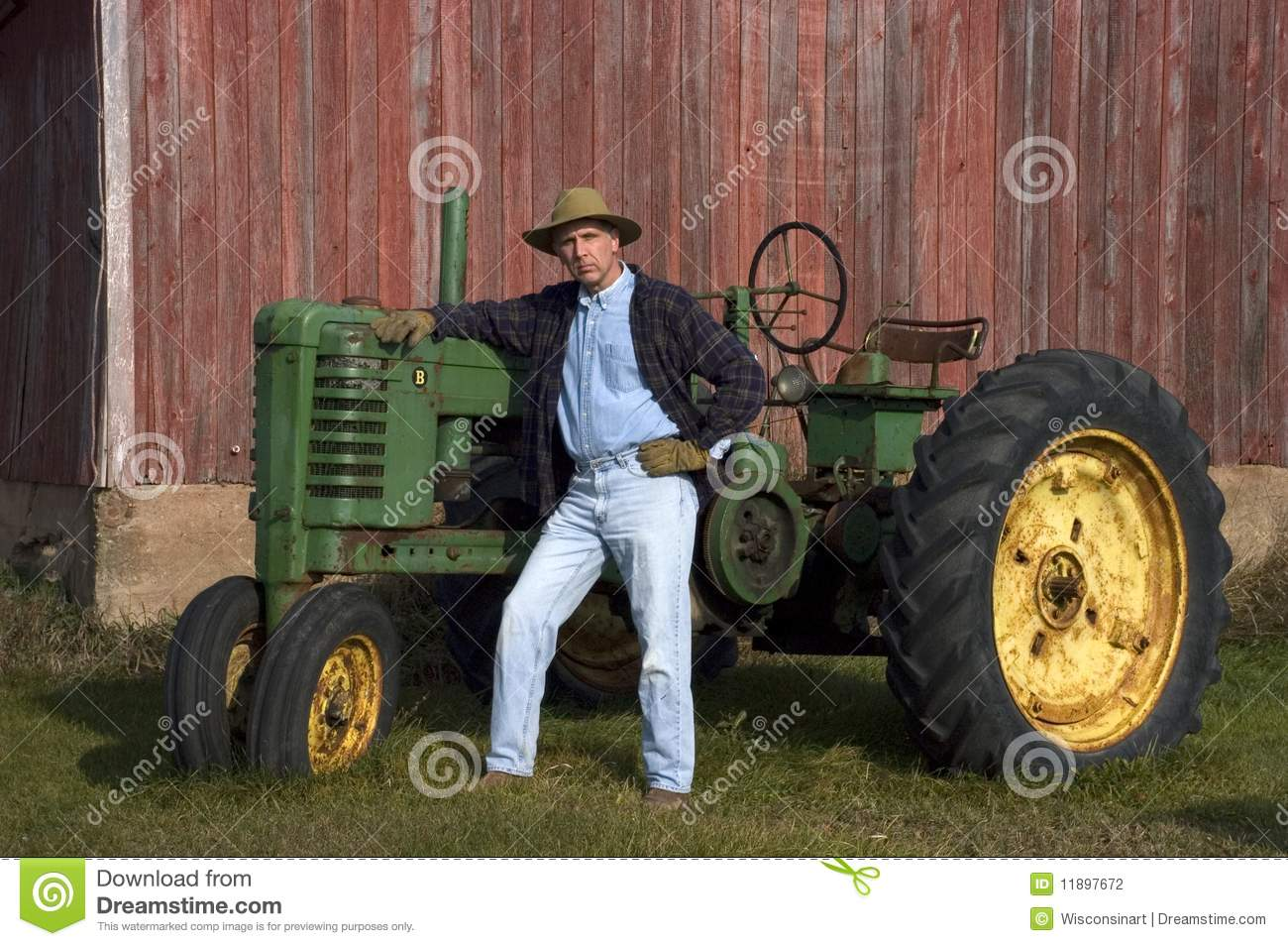Farmer On Tractor : Farmer poses with his tractor editorial photography