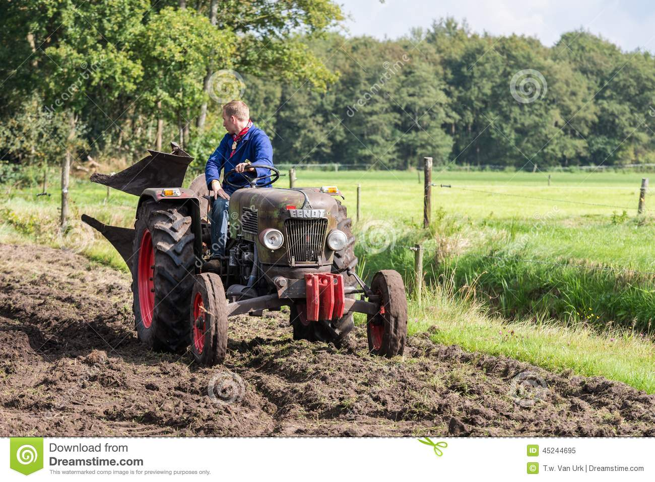 Farmer Riding With An Old Tractor During A Dutch ...