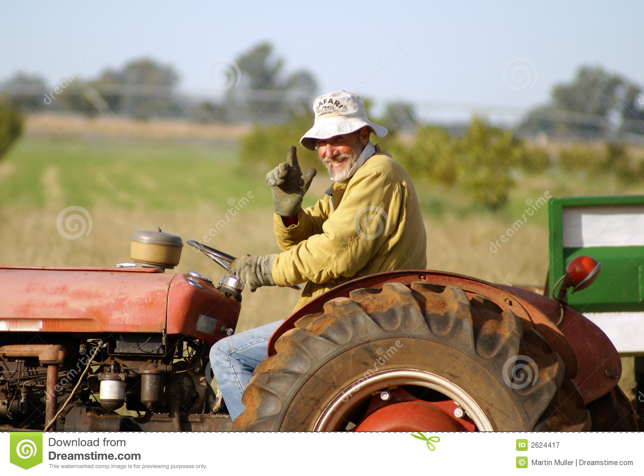 Farmer On Tractor : Farmer on tractor stock image of cold driving