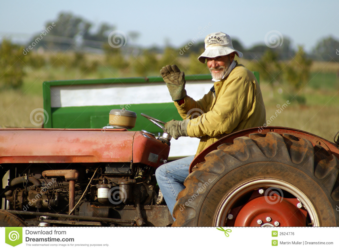 Farmer On Tractor Royalty Free Stock Image - Image: 2624776