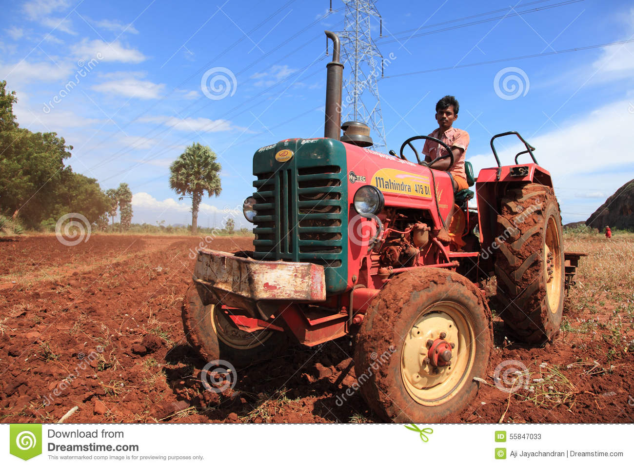 Farmer On Tractor : A farmer in tractor editorial stock photo image