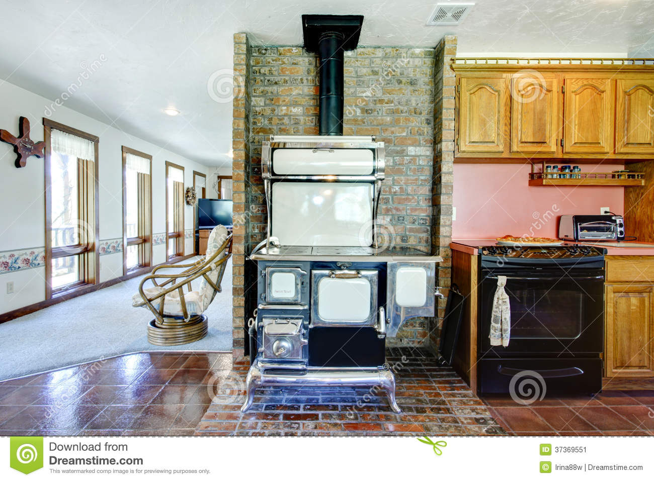 Farmhouse Kitchen Room With Antique Stove And Brick Background W Stock