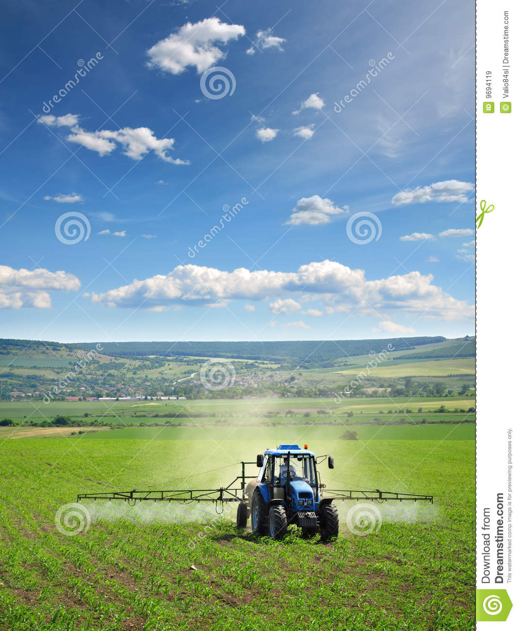Farming tractor plowing and spraying on field