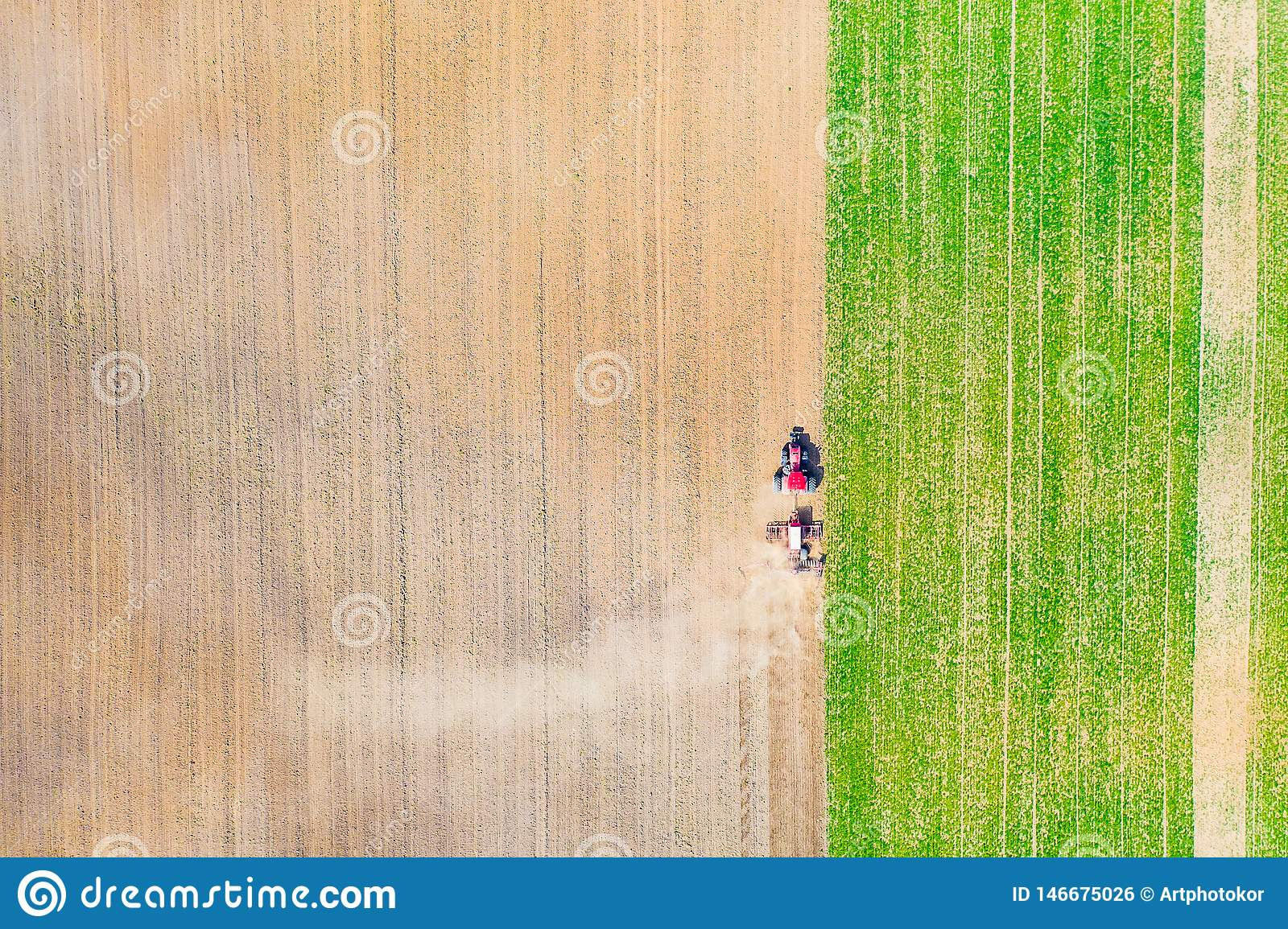 Farmland aerial texture. Tractor ploughing field in dry season
