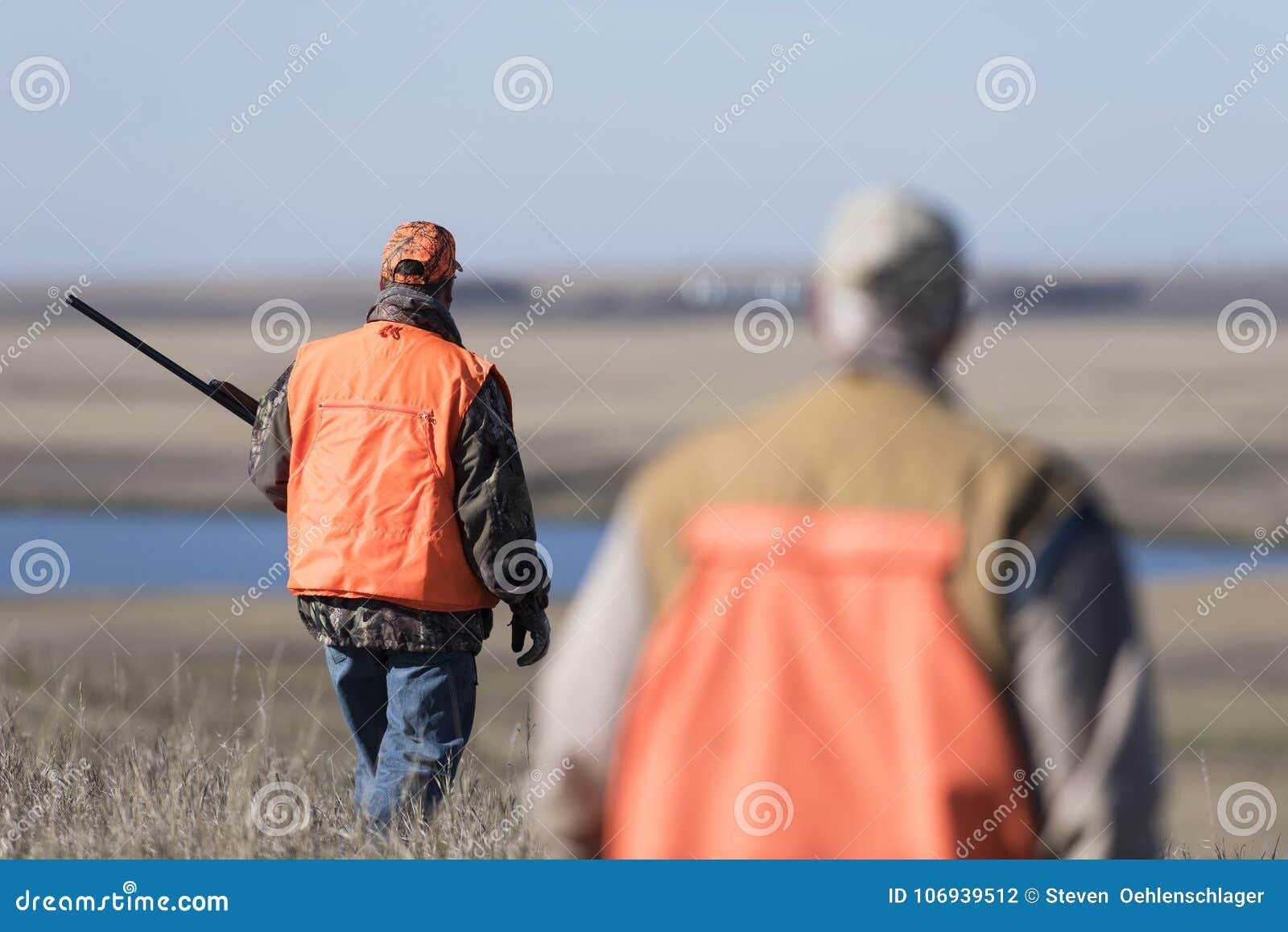 Fasanjägare i fält i North Dakota