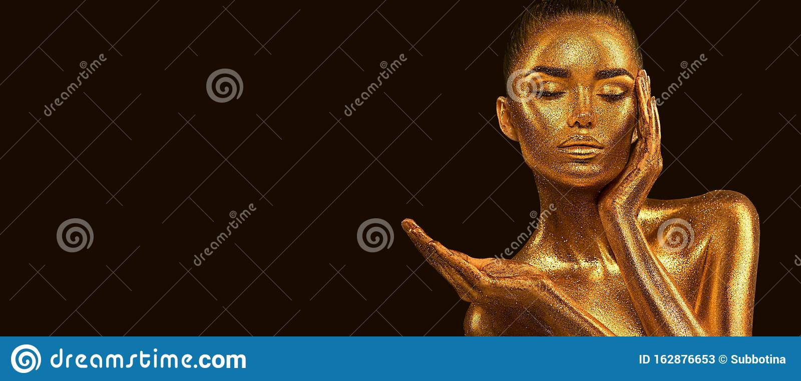 Fashion art Golden skin Woman face portrait closeup. Model girl with holiday golden Glamour shiny makeup. Sequins. Gold jewellery