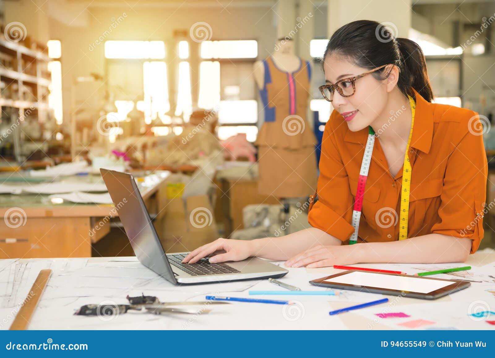 Fashion asian designer using computer