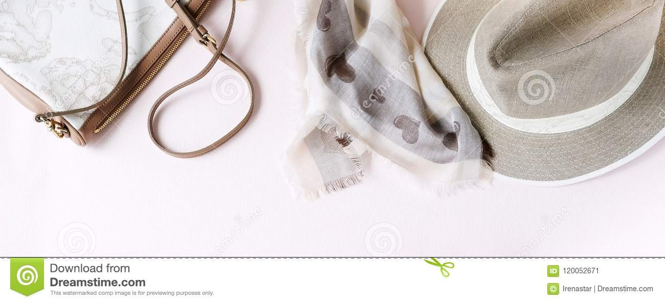 Fashion background. Female accessories in beige pastel colors