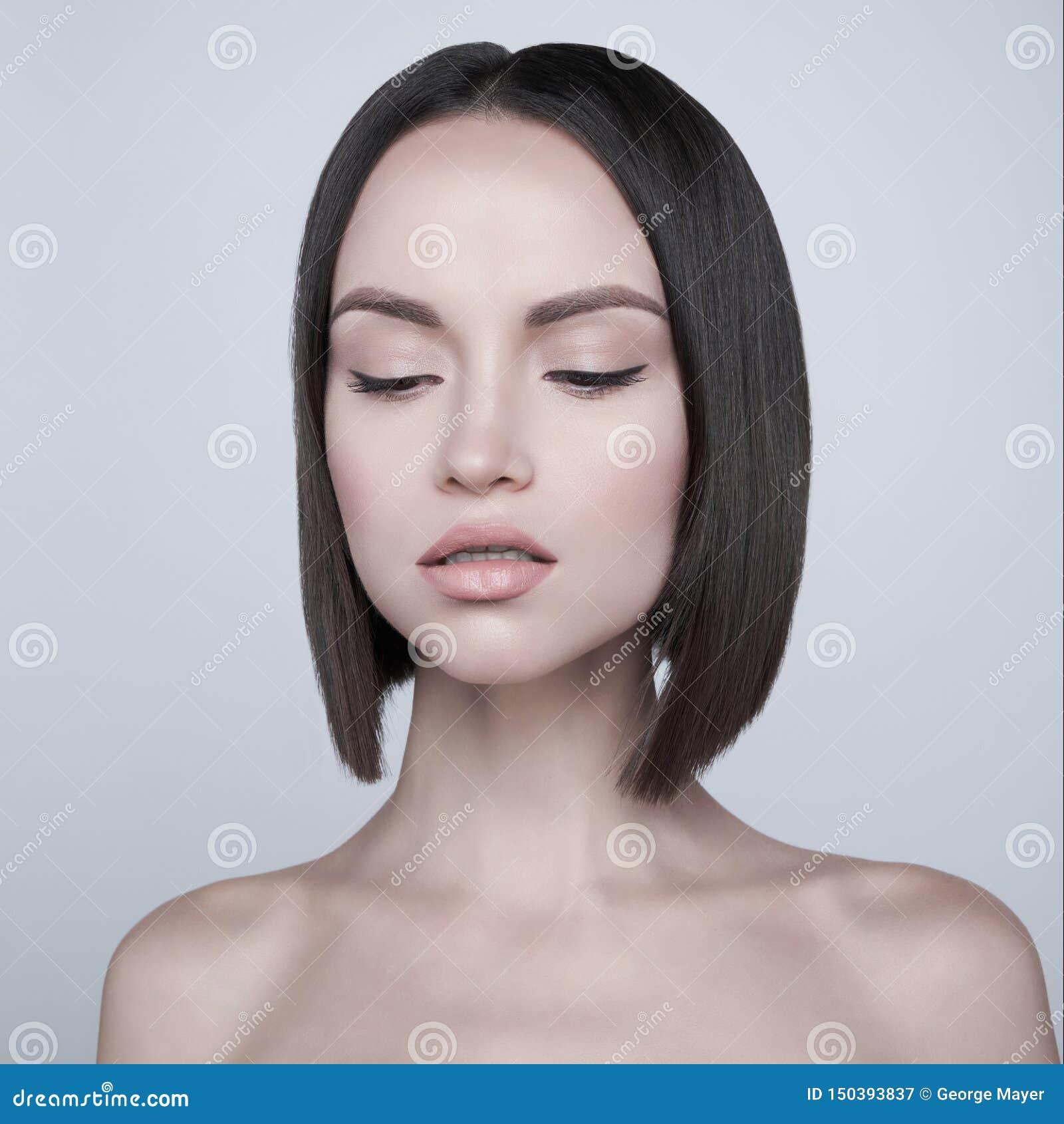Fashion beautiful brunette with short haircut. studio portrait